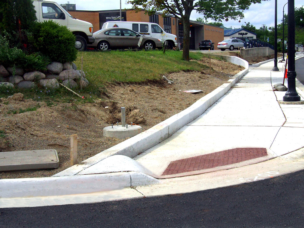 Ada accessible sidewalks buchheit construction for Removing concrete walkway