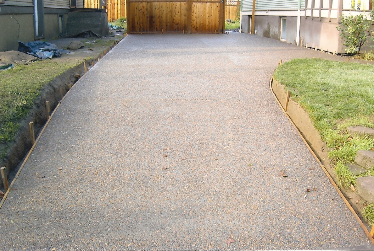 Exposed aggregate driveway pouring buchheit construction for How to pour a concrete driveway